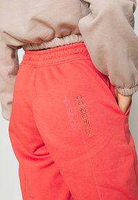 adidas Originals - Tracksuit bottoms - coral - 3