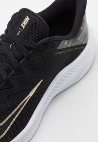 Nike Performance - QUEST 3 PRM - Neutral running shoes - black/metallic gold grain/iron grey - 5