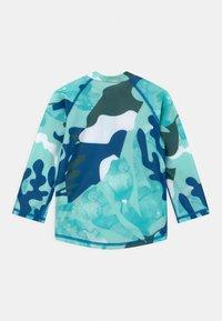 Reima - TUVALU UNISEX - Rash vest - blue - 1