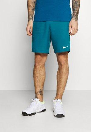 Pantalón corto de deporte - green abyss/white