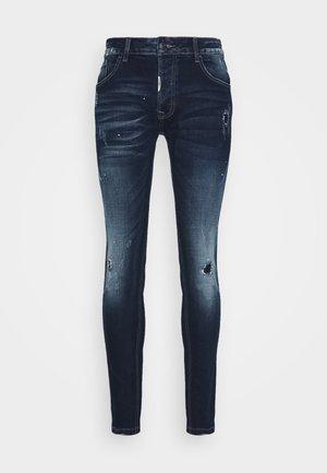 RANIERO  - Slim fit jeans - indigo