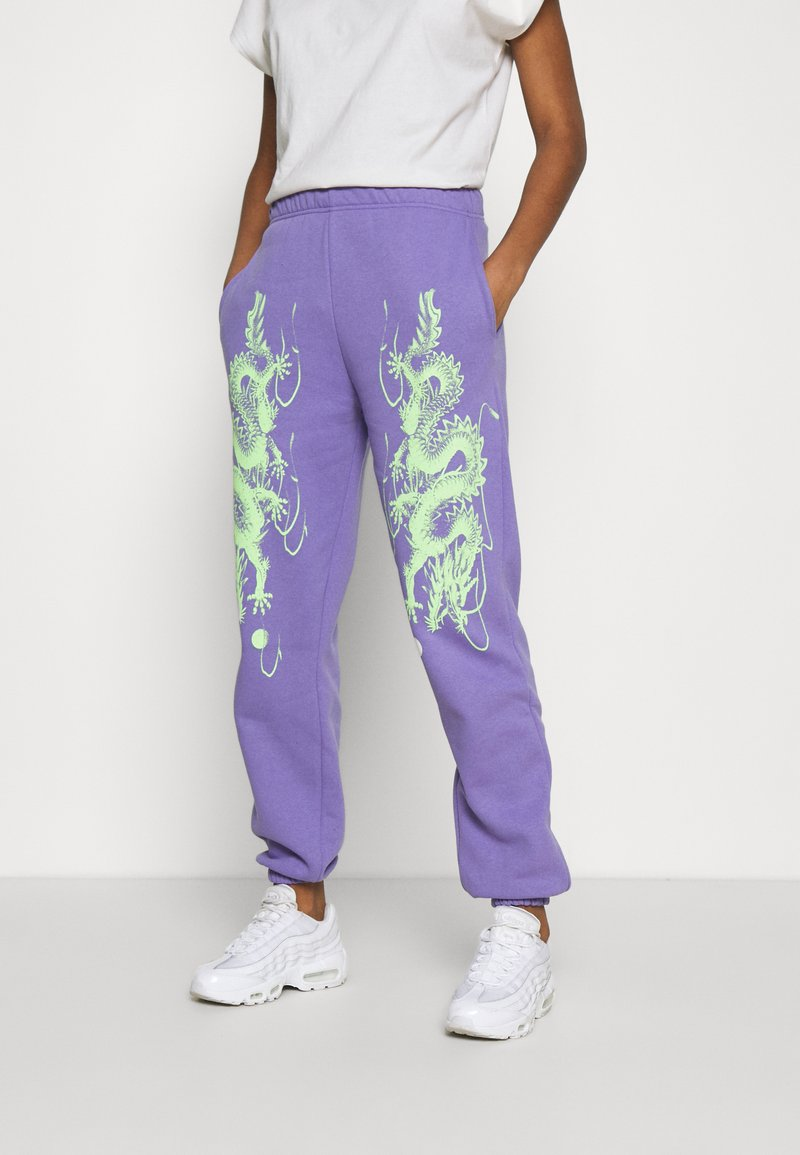 NEW girl ORDER - DRAGON JOGGERS - Verryttelyhousut - lilac