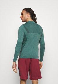 Endurance - JARO SEAMLESS MIDLAYER - Long sleeved top - ponderosa pine - 2