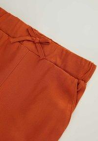 DeFacto - Tracksuit bottoms - orange - 2