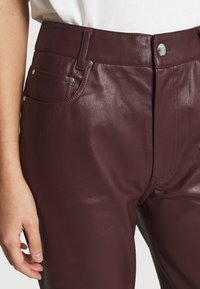 EDITED - MARESA TROUSERS - Trousers - rot - 4