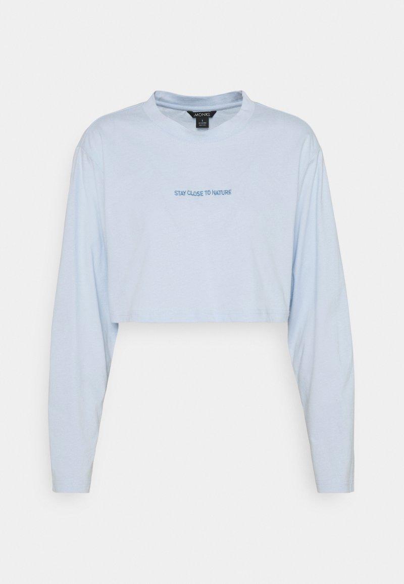 Monki - T-shirt à manches longues - blue light