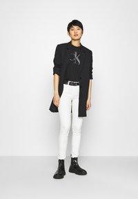 Calvin Klein Jeans - BONDED FILLED TEE - Camiseta estampada - black - 1