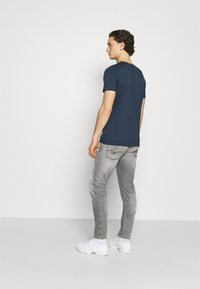 Replay - ANBASS AGED ECO - Slim fit jeans - medium grey - 2