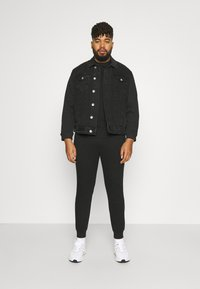 Johnny Bigg - TROY CUFF TRACKPANT - Tracksuit bottoms - black - 1