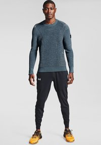 Under Armour - FLY FAST - Pantalon de survêtement - black - 0