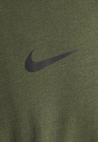 Nike Performance - BURNOUT - Print T-shirt - rough green/jade smoke/black - 2