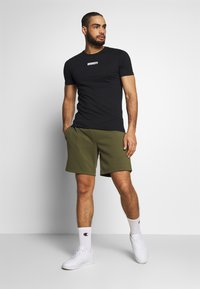 Jack & Jones Performance - JCOZSS TEE - Basic T-shirt - black - 1