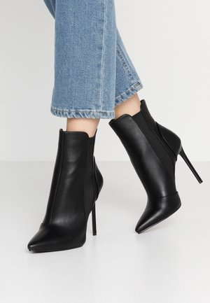 AXELLE - Bottines à talons hauts - black