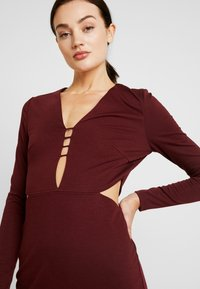 Lost Ink - CUT OUT SIDE BODYCON - Cocktail dress / Party dress - burgundy - 4