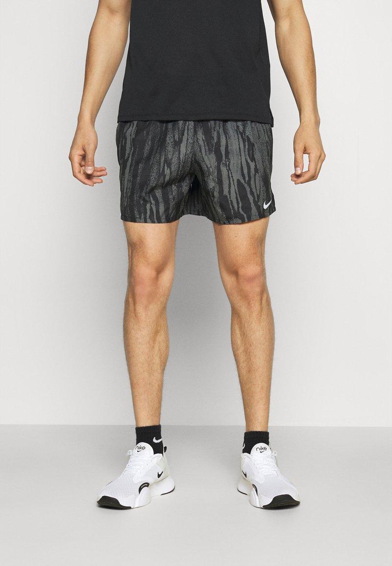 Nike Performance - SHORT - Sports shorts - black