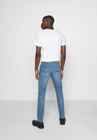 Levi's® - 512™ SLIM TAPER - Jeans Tapered Fit - med indigo