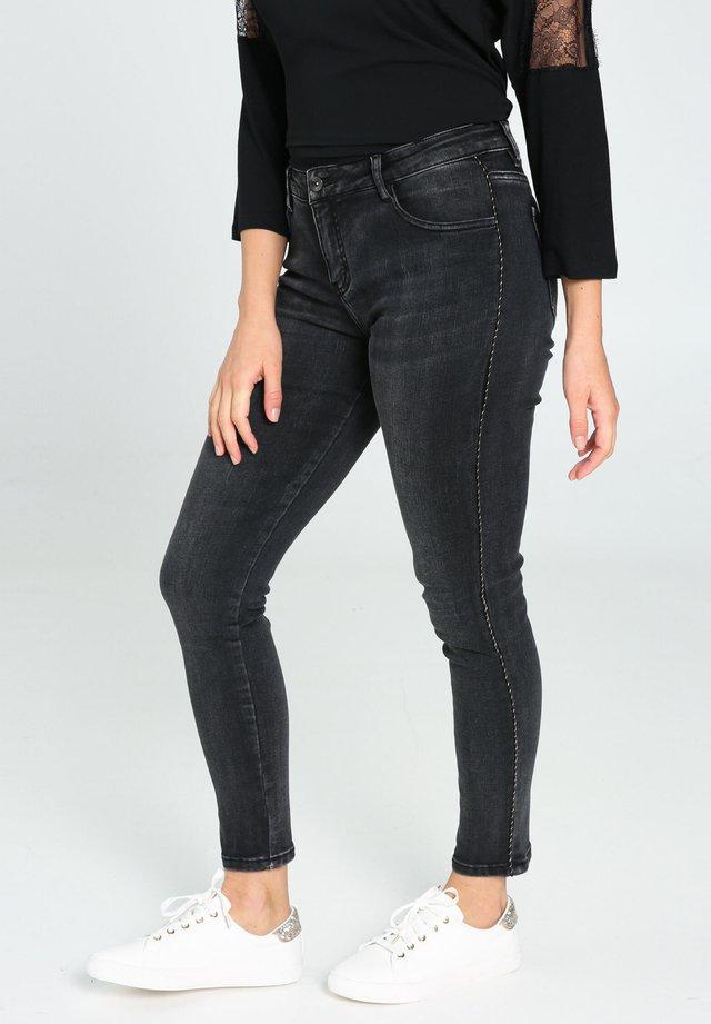 MIT SILBERFARBENEN STREIFEN - Jeans Skinny Fit - black