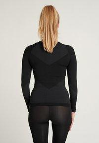 Hummel - Langærmede T-shirts - black - 1