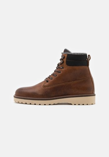 RODEN - Lace-up ankle boots - cognac
