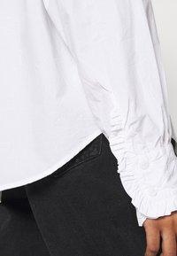 Monki - MADDY BLOUSE - Button-down blouse - white light - 5