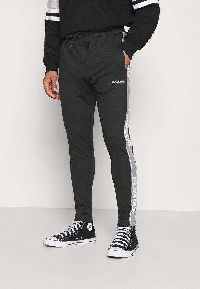 LOGO PANTS UNISEX - Teplákové kalhoty - black/coconut milk