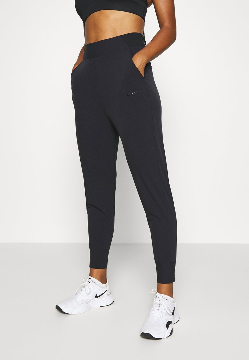 Nike Performance - BLISS - Tracksuit bottoms - black
