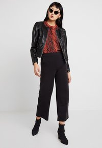 ONLY - ONLNEWMONA JACKET - Faux leather jacket - black - 1
