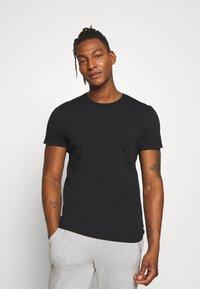 Peak Performance Urban - URBAN TEE - Basic T-shirt - black - 0