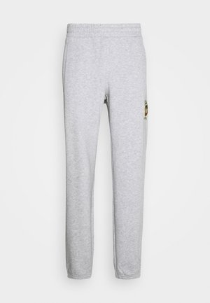 COLLEGIATE CREST UNISEX - Tracksuit bottoms - light grey