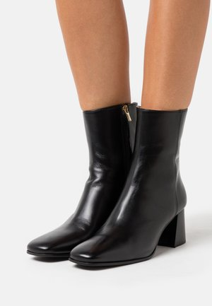 SYBELLA - Kotníkové boty - black