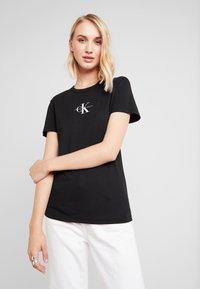 Calvin Klein Jeans - MONOGRAM SLIM RINGER TEE - Print T-shirt - black - 0