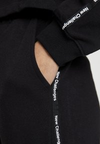 PULL&BEAR - Tracksuit bottoms - black - 5