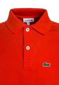Lacoste - Polo shirt - etna - 2