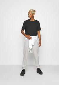 YOURTURN - UNISEX - Pantaloni sportivi - mottled light grey - 1