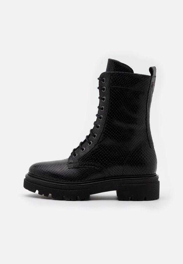 UNDER - Platform ankle boots - black