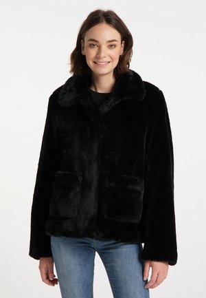 Vinterjacka - schwarz