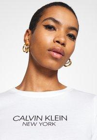 Calvin Klein - 2 PACK - Triko spotiskem - black/white - 4