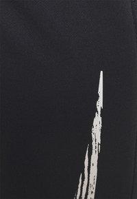 Nike Performance - ESSENTIAL PANT - Pantalones deportivos - black/reflective silver - 4