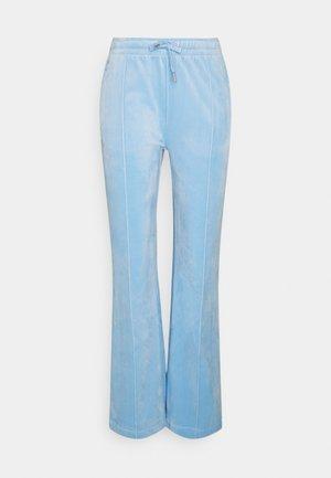 TINA TRACK  - Tracksuit bottoms - powder blue