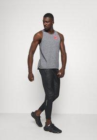 Nike Performance - Teplákové kalhoty - black/reflective silver - 1