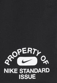 Nike Performance - STANDARD ISSUE  - Träningsshorts - black/pale ivory - 5