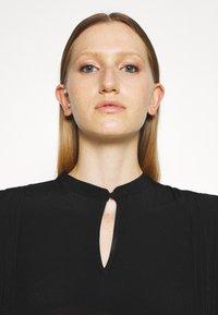 Bruuns Bazaar - LILLI COVER DRESS - Day dress - black - 4