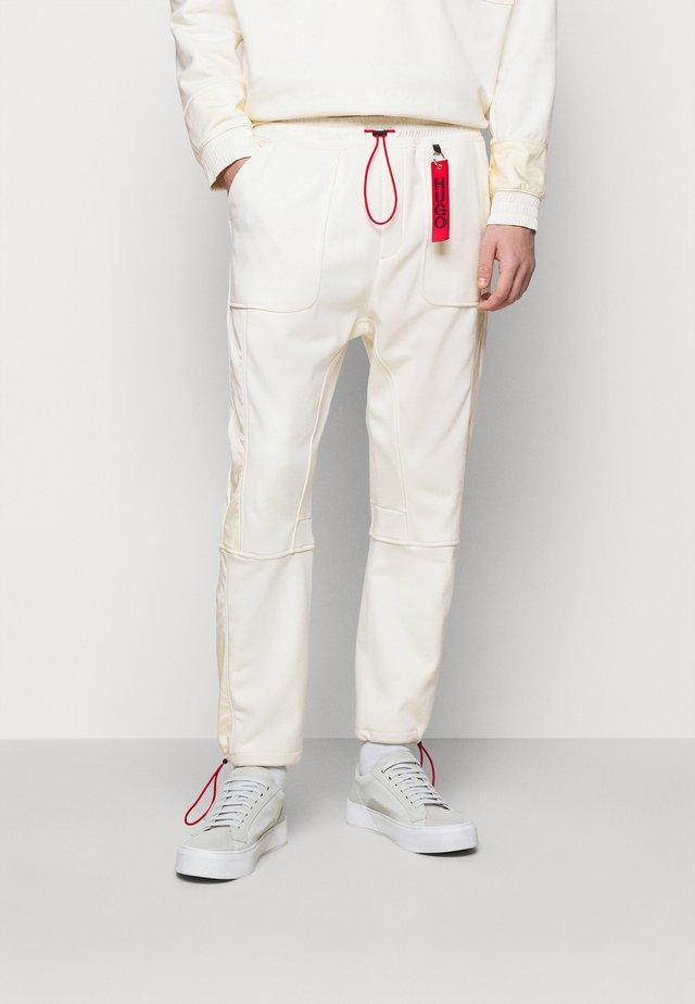 DANGOLIN  - Pantalon de survêtement - natural