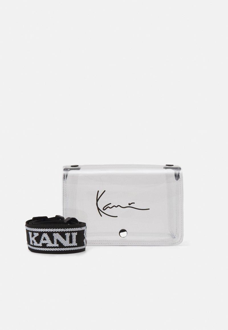 Karl Kani - SIGNATURE TAPE SMALL - Across body bag - transperent