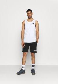 The North Face - RAINBOW SHORT - Pantalón corto de deporte - black - 1