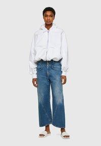 Diesel - DE-REGGYNAL-SP - Relaxed fit jeans - light blue - 1