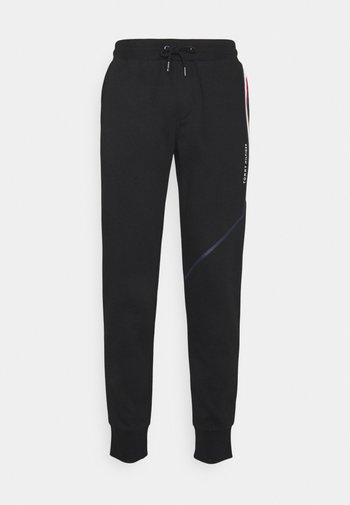 SPLIT STRIPE  - Pantaloni sportivi - black