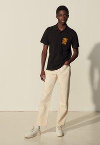 sandro - TEDDY - Polo shirt - noir - 0