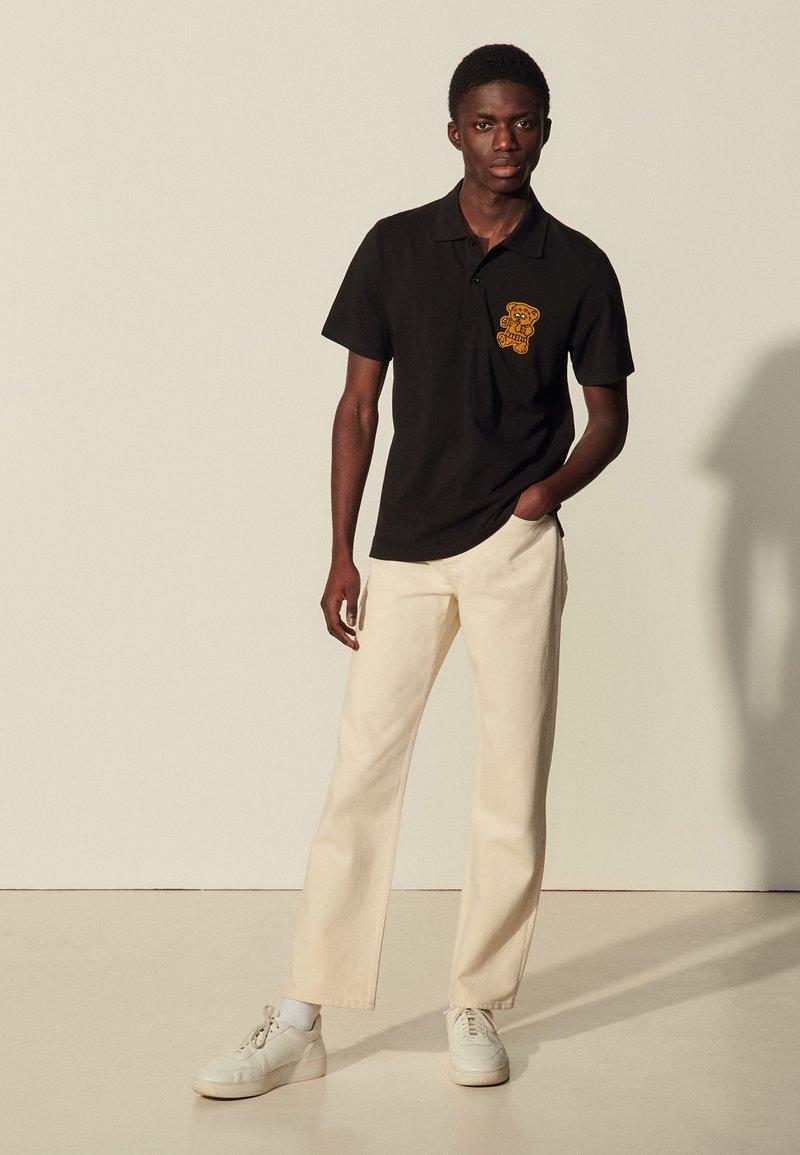 sandro - TEDDY - Polo shirt - noir