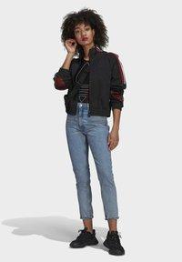 adidas Originals - ADICOLOR TRICOLOR TREFOIL PRIMEBLUE TRACK TOP - Training jacket - black - 1